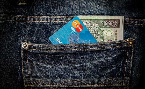 jeans with credit card and cash in back pocket